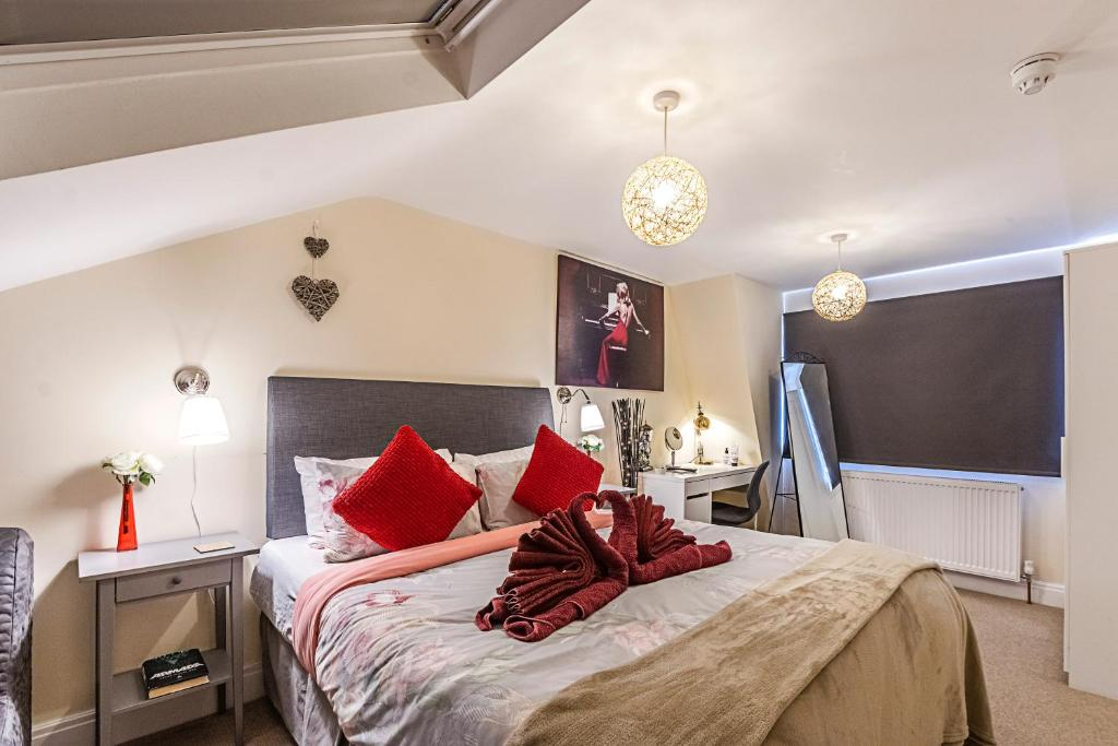 A bed or beds in a room at Greyhound Road Rooms
