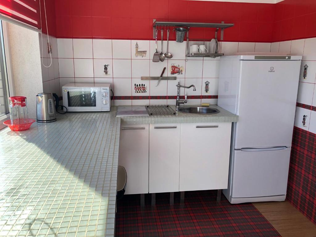 A kitchen or kitchenette at Azovskaya Rivera