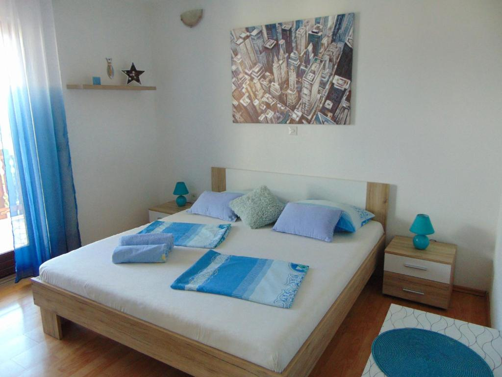 A bed or beds in a room at Apartments Marko