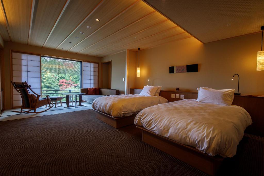 A bed or beds in a room at Nakanobo Zuien (Adult Only)