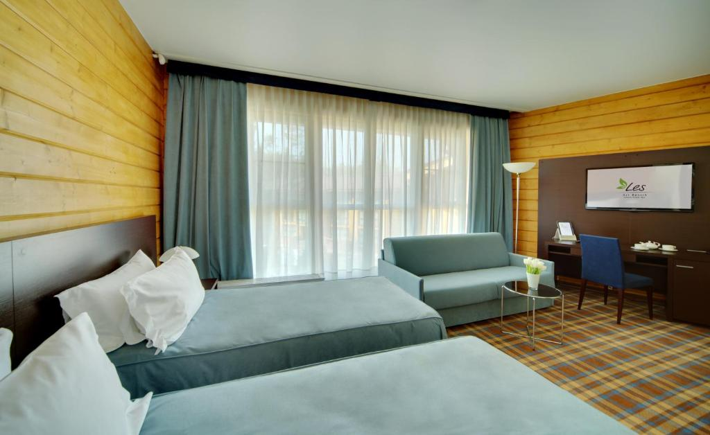A bed or beds in a room at LES Art Resort