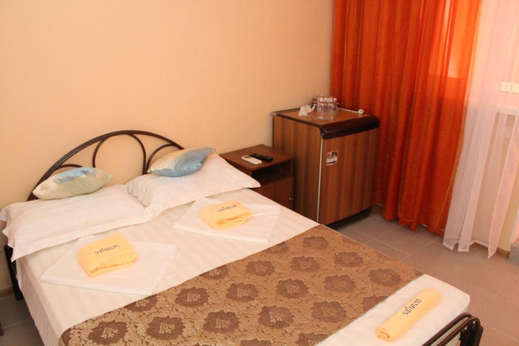 Кровать или кровати в номере Saluton