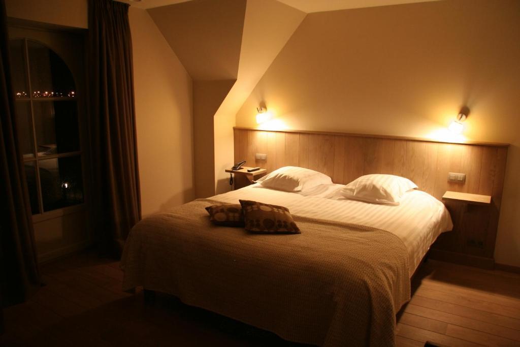Un ou plusieurs lits dans un hébergement de l'établissement HuysHoeve