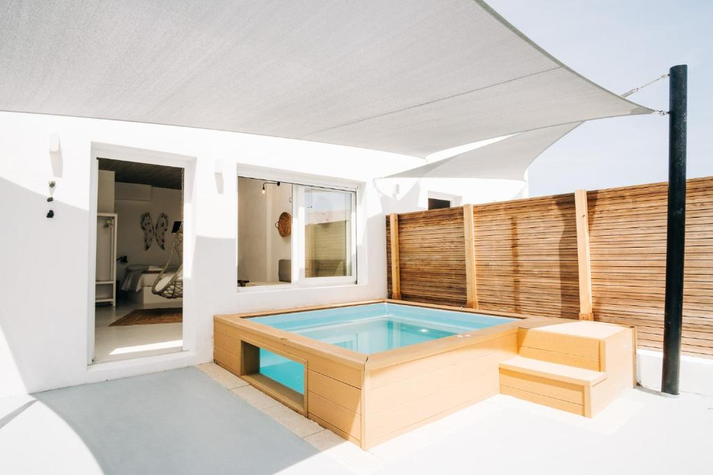 The swimming pool at or near Mesanto Luxury Suites