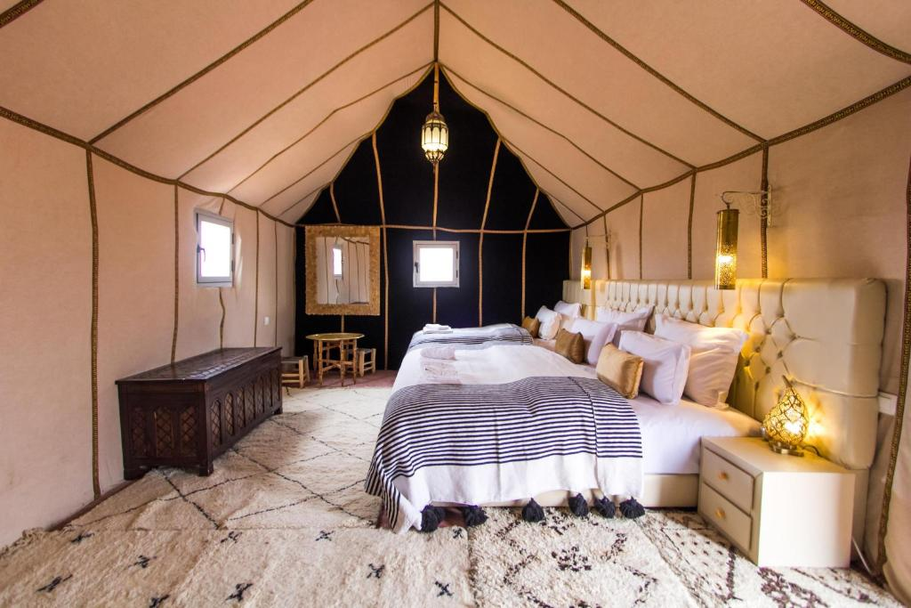 A bed or beds in a room at Orient Desert Camp