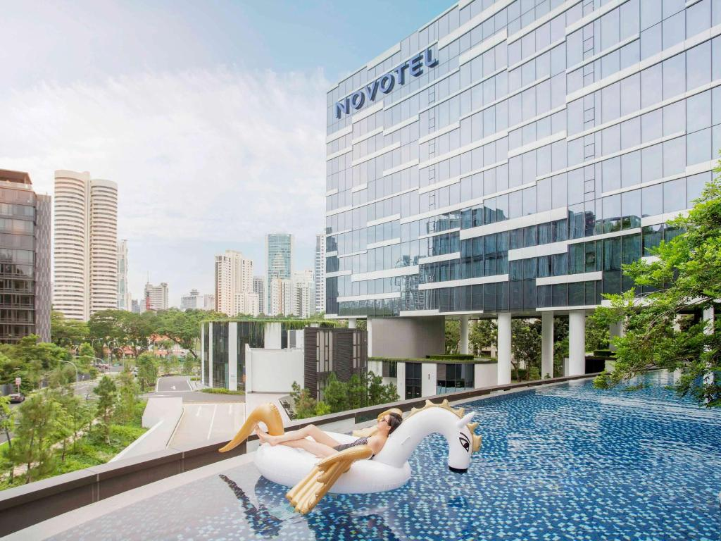 The swimming pool at or near Novotel Singapore On Stevens