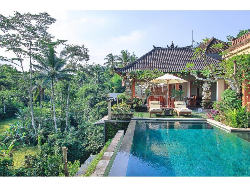 The swimming pool at or near Tapa Nata Ubud by Pramana