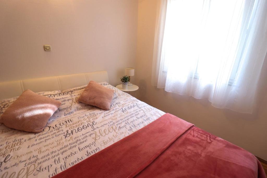 Postelja oz. postelje v sobi nastanitve Apartment Mia