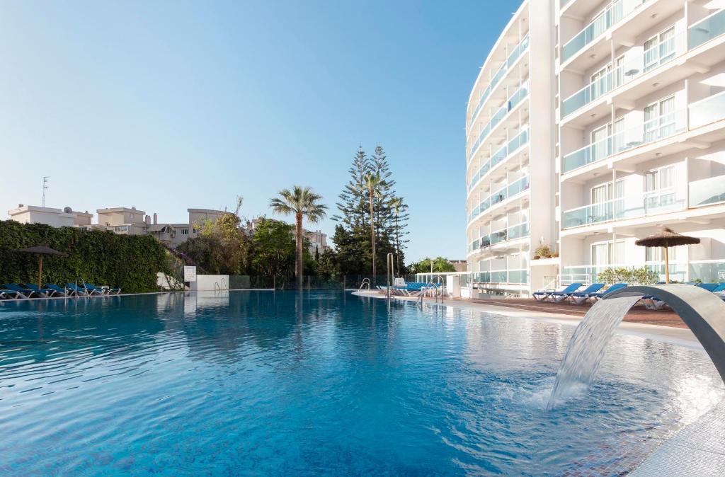 The swimming pool at or near Hotel Palia Las Palomas
