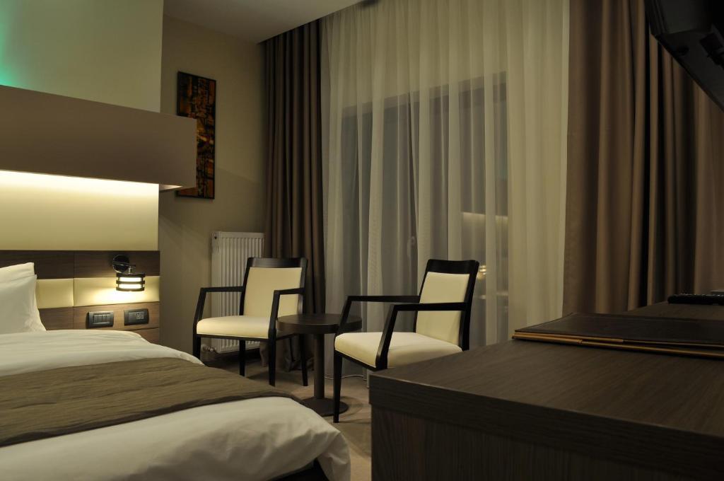 Uma cama ou camas num quarto em Hotel Scapino