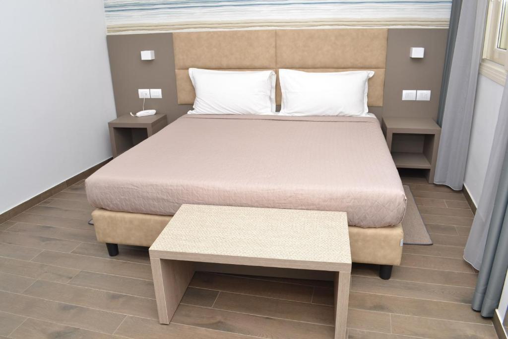 Un ou plusieurs lits dans un hébergement de l'établissement International Hotel Dakar
