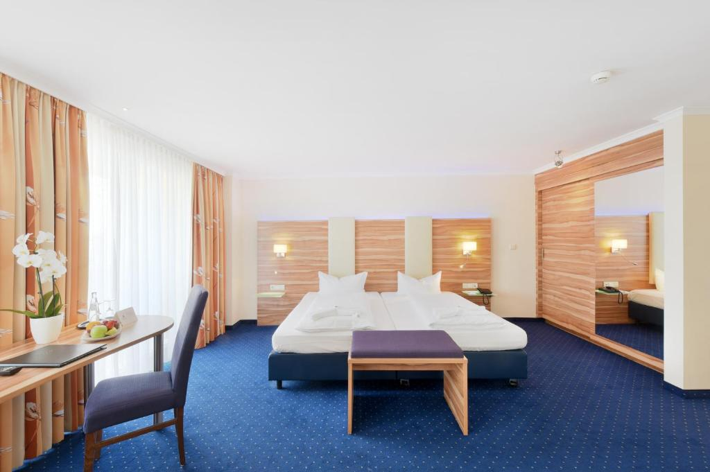 A bed or beds in a room at Hotel Vitalis by Amedia