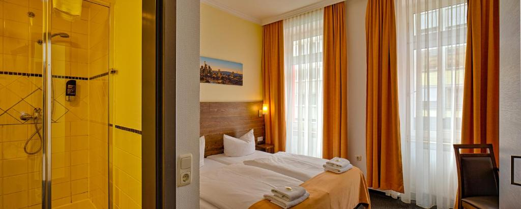 A bed or beds in a room at Metro Hotel Frankfurt City by Trip Inn