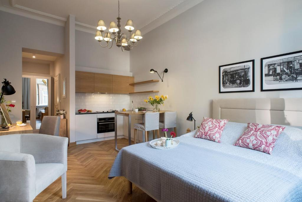 A bed or beds in a room at Belle Epoque Residence