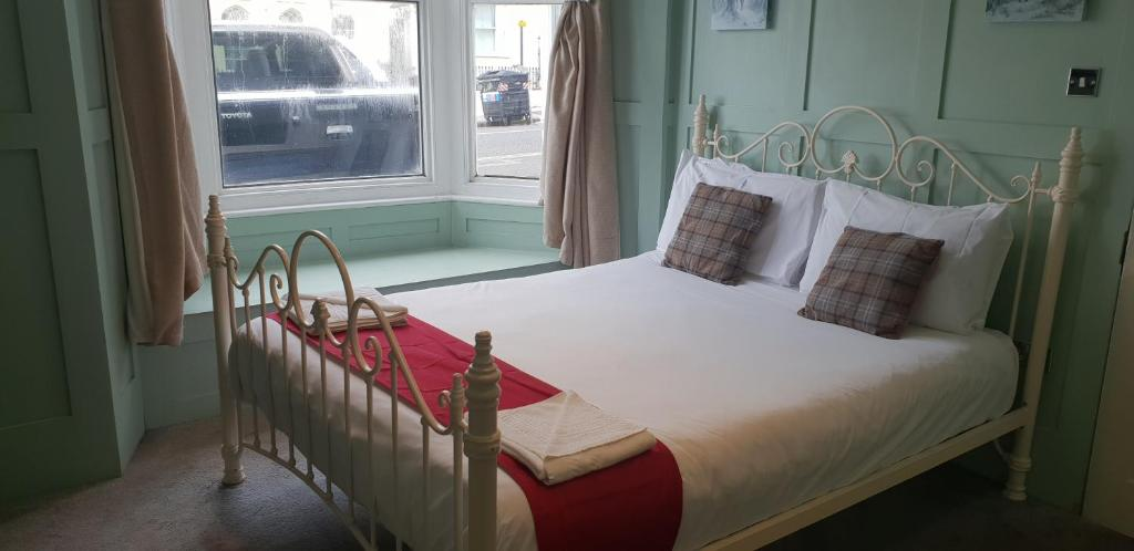A bed or beds in a room at The Willows