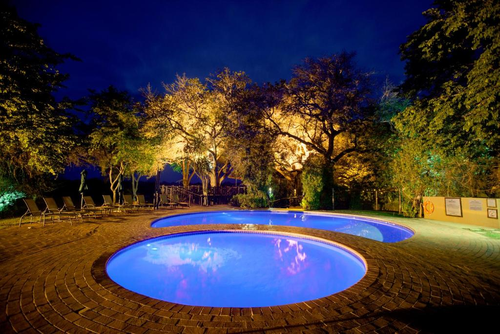 The swimming pool at or near Protea Hotel by Marriott Kruger Gate