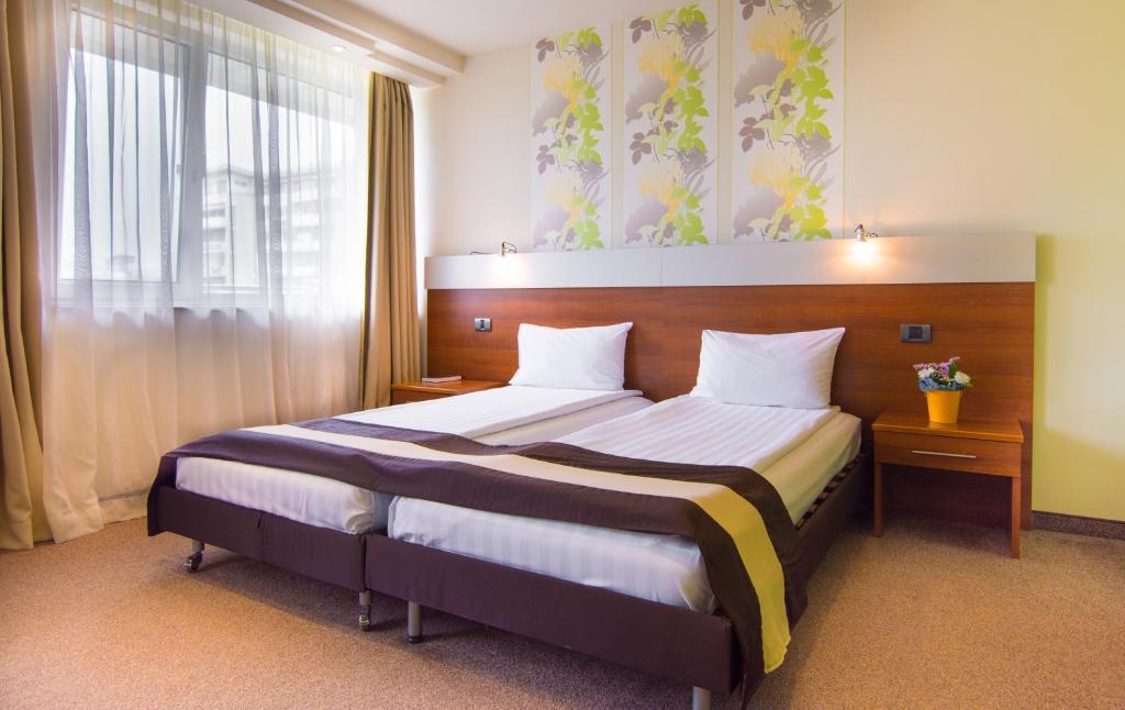 Cama o camas de una habitación en Hotel Forum