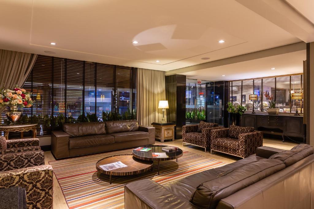 The lobby or reception area at Faial Prime Suítes