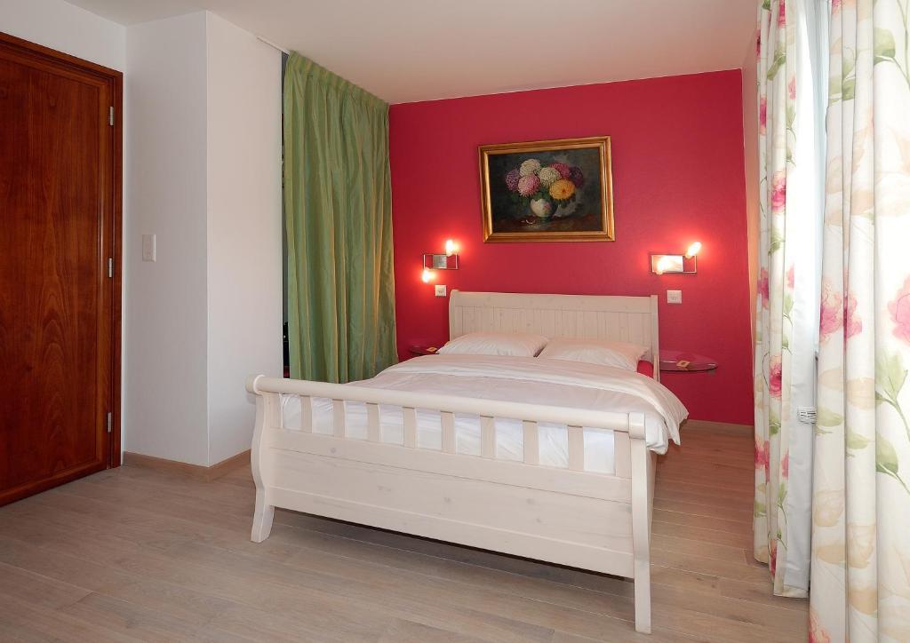 Ein Bett oder Betten in einem Zimmer der Unterkunft Auberge de Dully