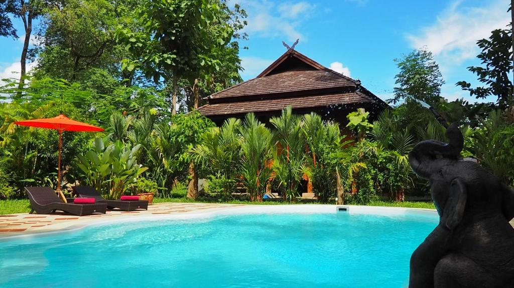 The swimming pool at or near Nan Seasons Boutique Resort