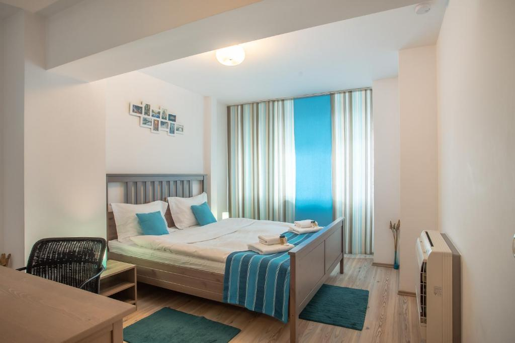 A bed or beds in a room at Scala Suite