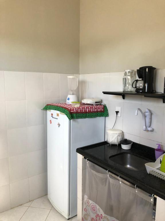 Una cocina o zona de cocina en Casas Aracaju Temporada