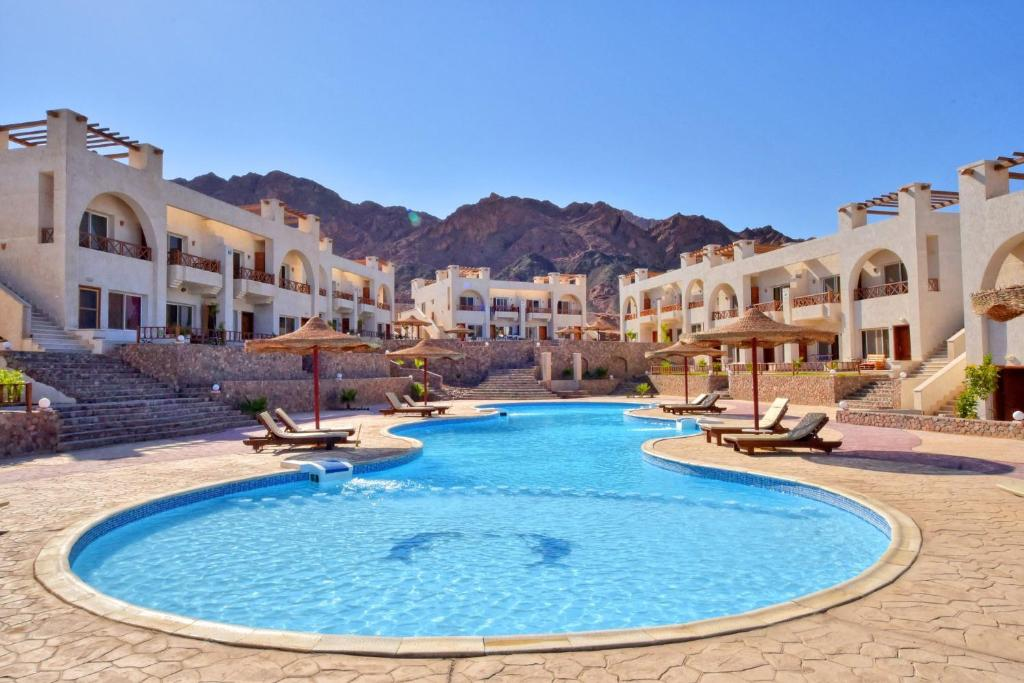 The swimming pool at or near Sunny Vacation Dahab