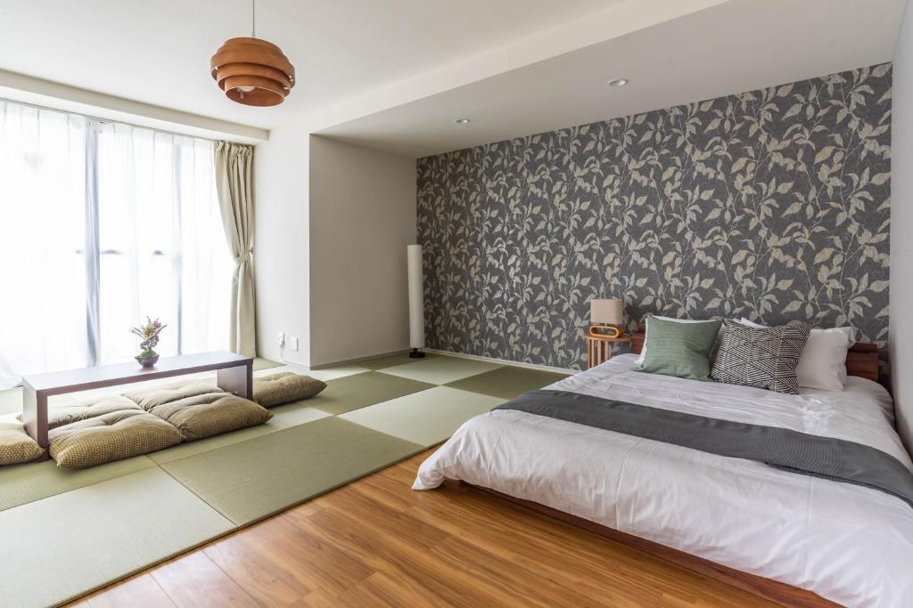 A bed or beds in a room at Mido Elufan Building