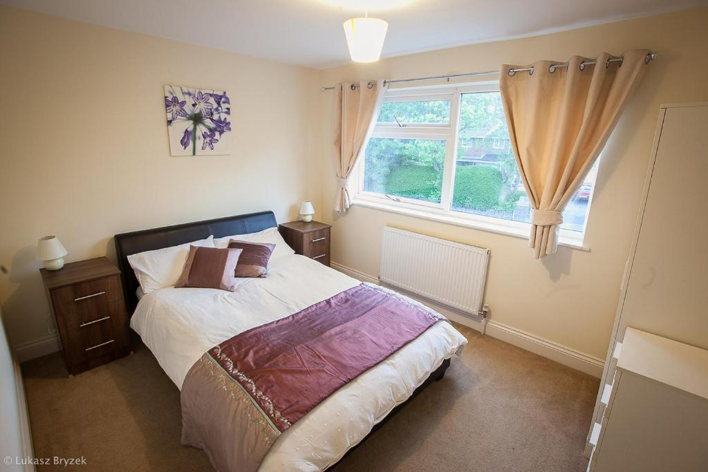 A bed or beds in a room at House by Five Ways Station and City Centre