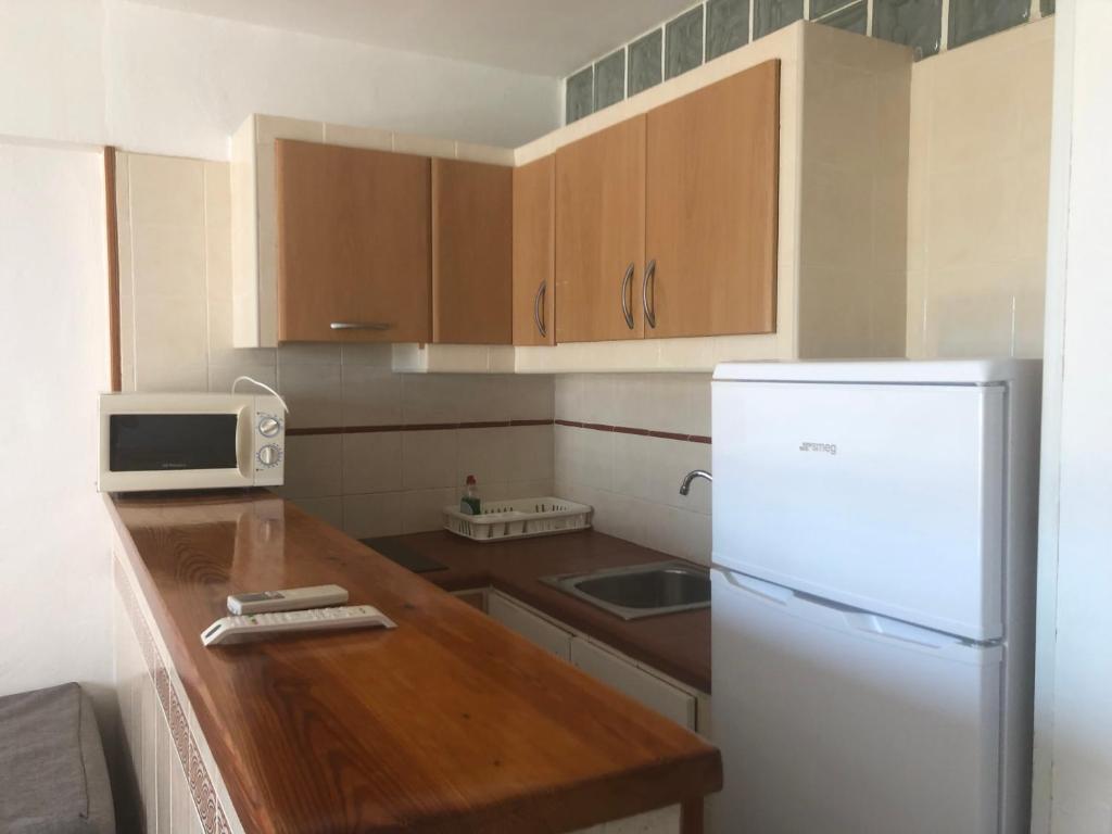 A kitchen or kitchenette at Apartamentos Llevant