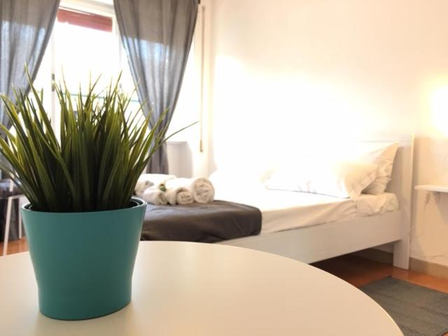 A bed or beds in a room at Apartment near the Vatican City 2