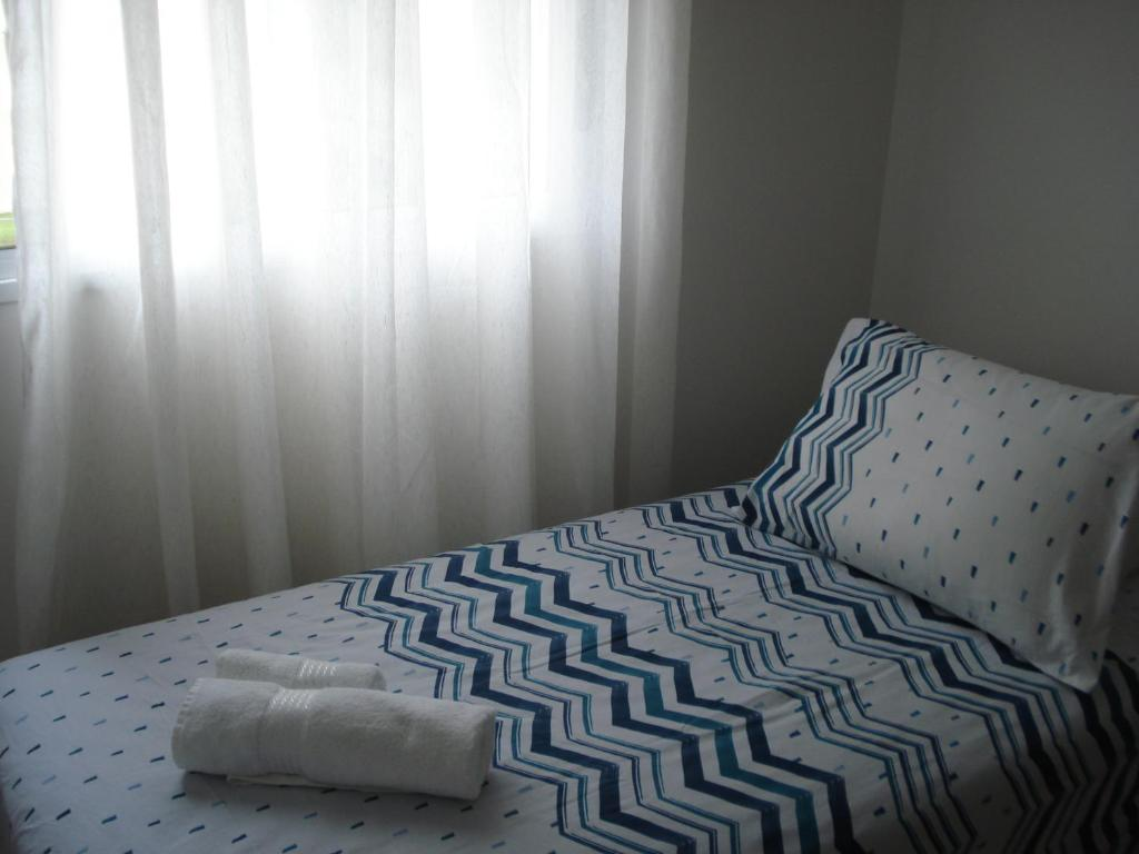 A bed or beds in a room at ARENA GREMIO APTO LUXO WIFI ESTAC arcond 5 PESSOAS