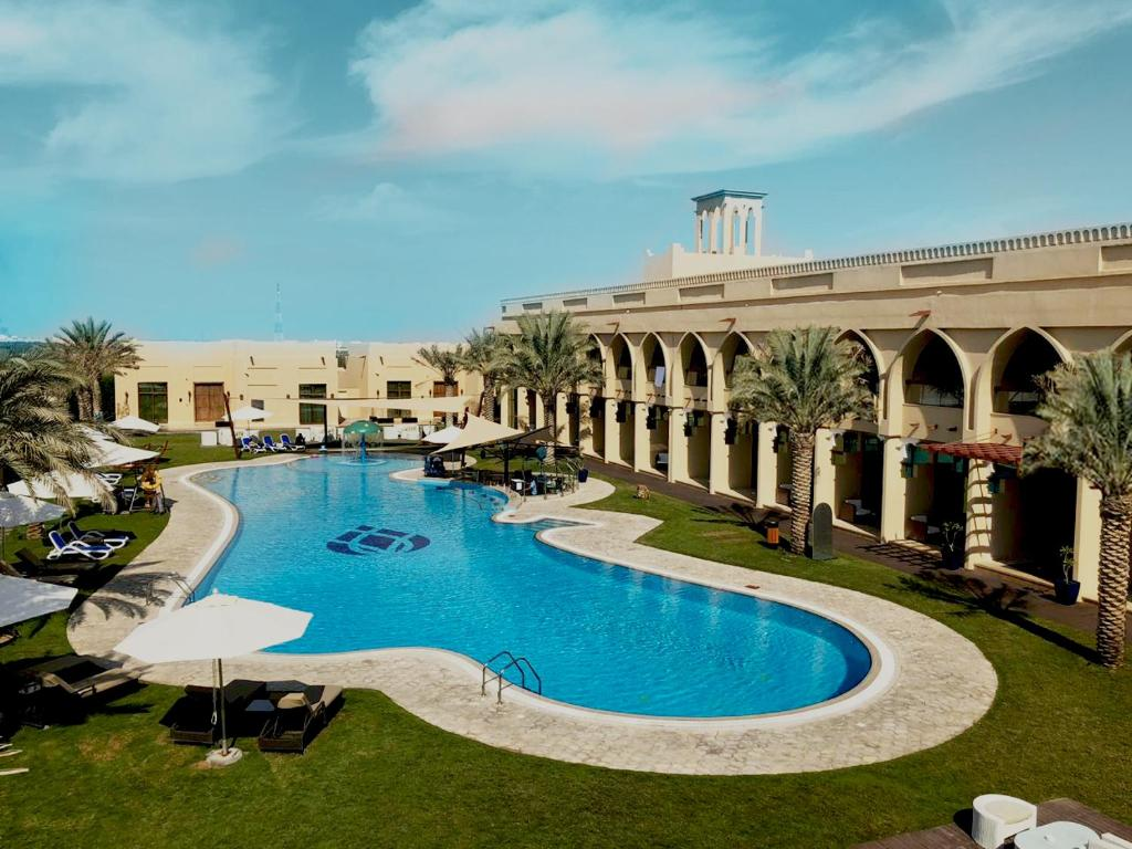 The swimming pool at or near Western Hotel - Madinat Zayed