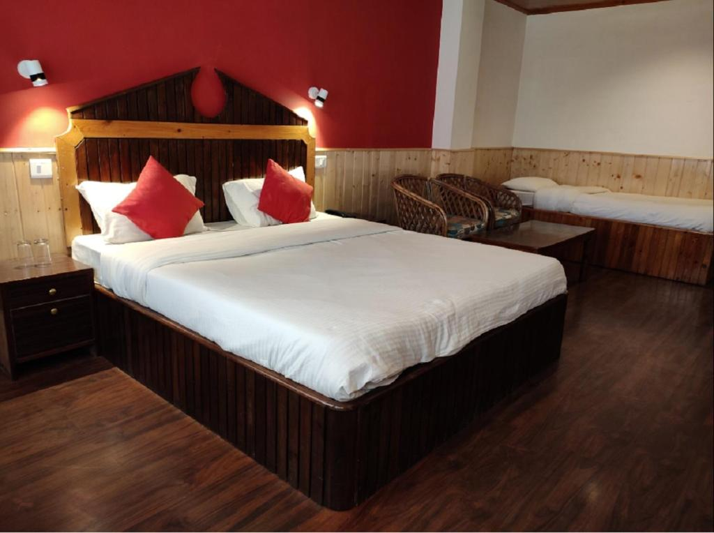 A bed or beds in a room at Hotel Madhuban Shimla
