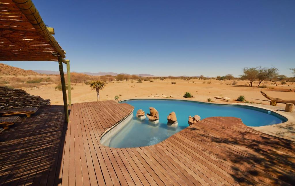 The swimming pool at or near Solitaire Desert Farm