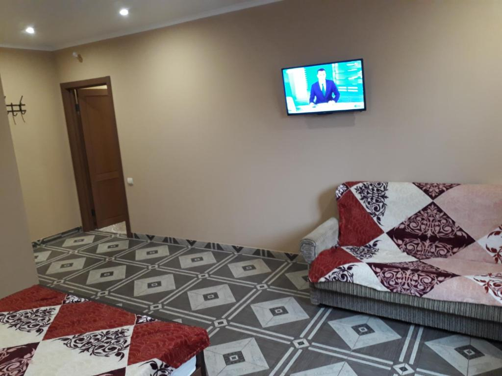 A television and/or entertainment center at Guest House Bereg