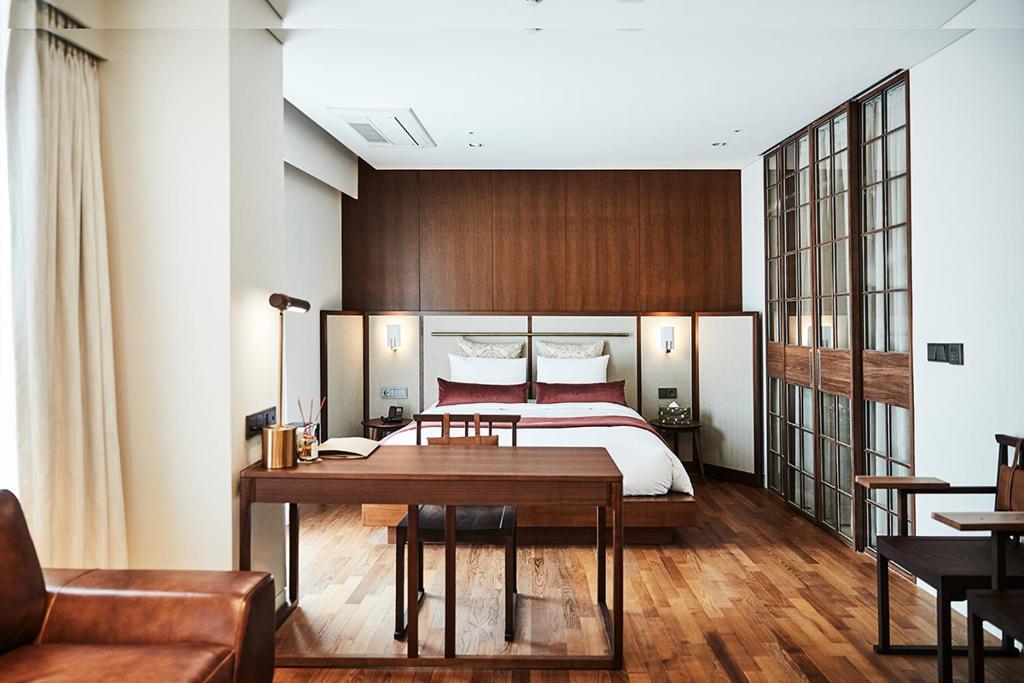 เตียงในห้องที่ La Casa Hotel Seoul