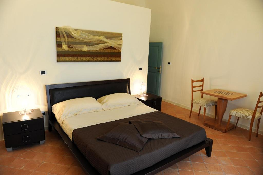 A bed or beds in a room at All'Annunziata Vecchia