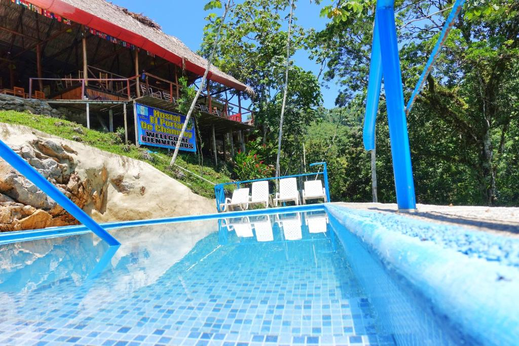 The swimming pool at or near El Portal De Champey
