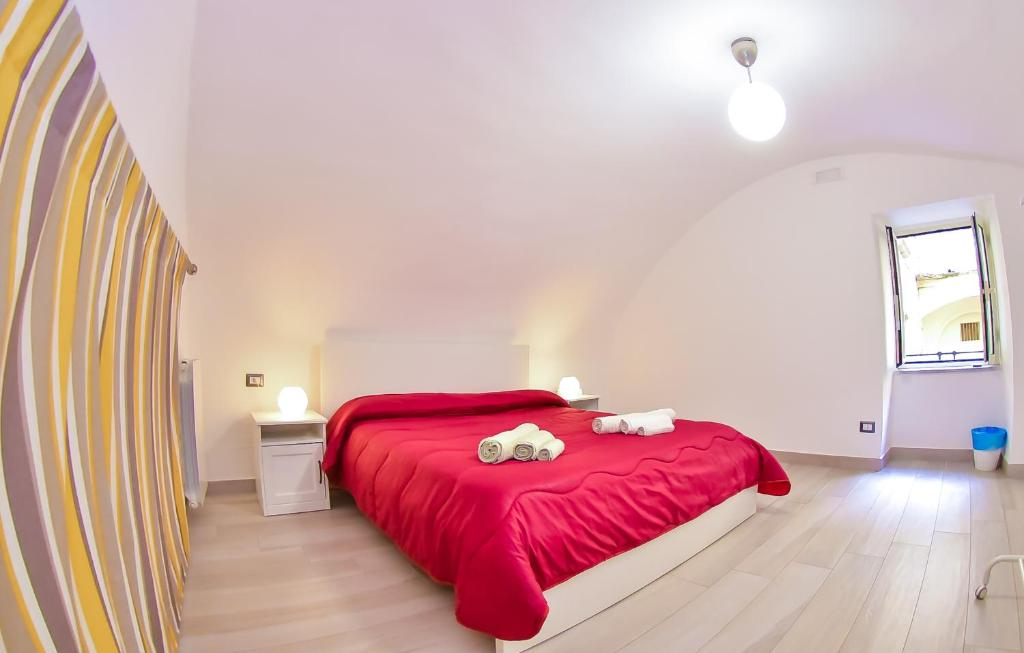 A bed or beds in a room at Vecchia Napoli - Anticaglia