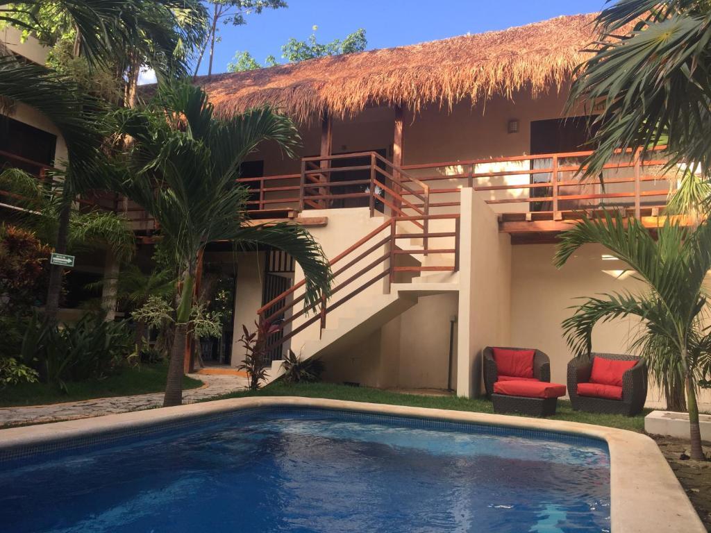The swimming pool at or near Hotel Uolis Nah