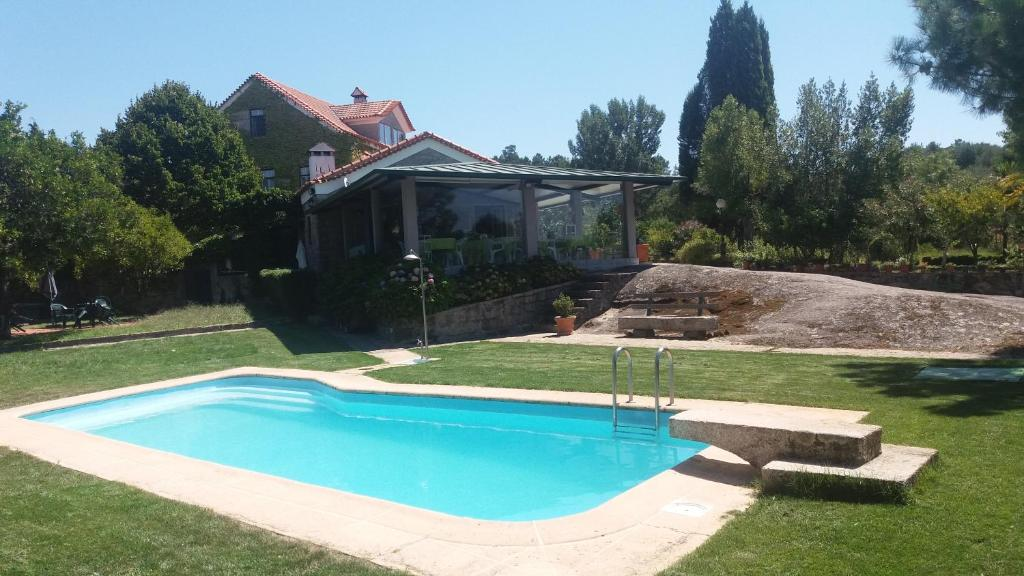 The swimming pool at or near Quinta da Florencia - Serra Estrela
