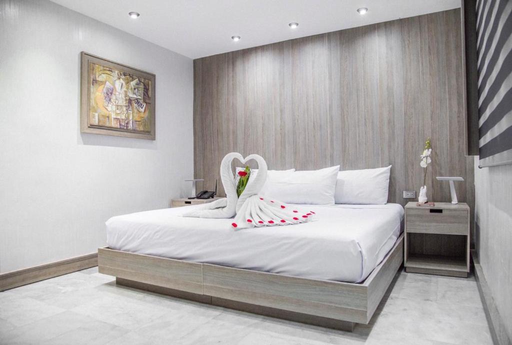 Cama o camas de una habitación en Hotel Majestic Playacar