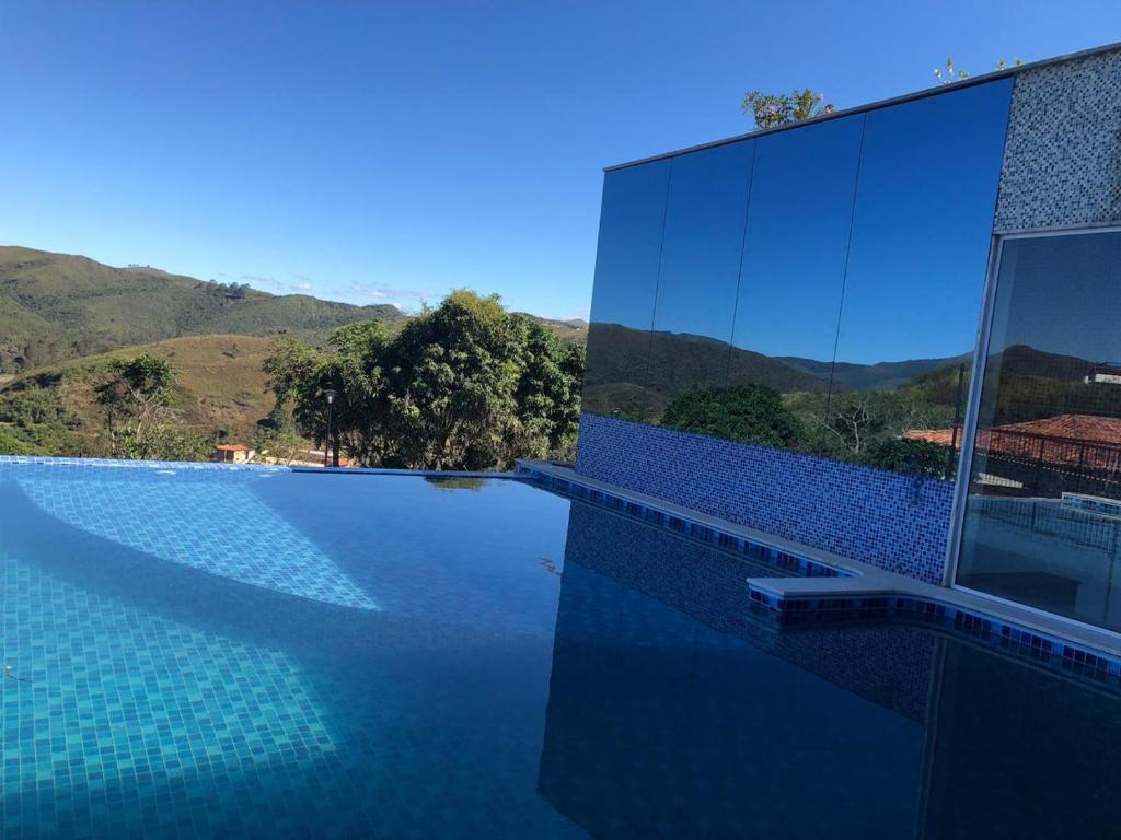The swimming pool at or close to Hotel Recanto da Serra