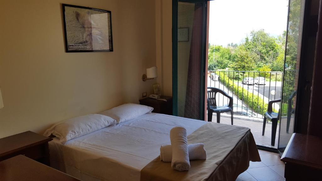Łóżko lub łóżka w pokoju w obiekcie Casa Betania