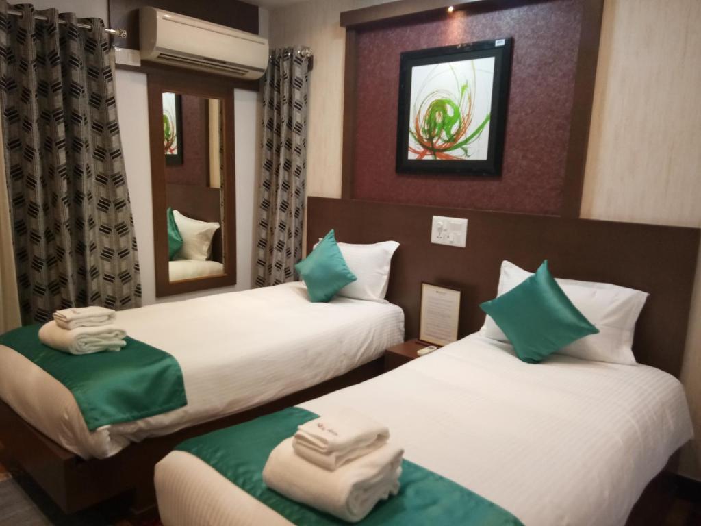Posteľ alebo postele v izbe v ubytovaní Square Suite
