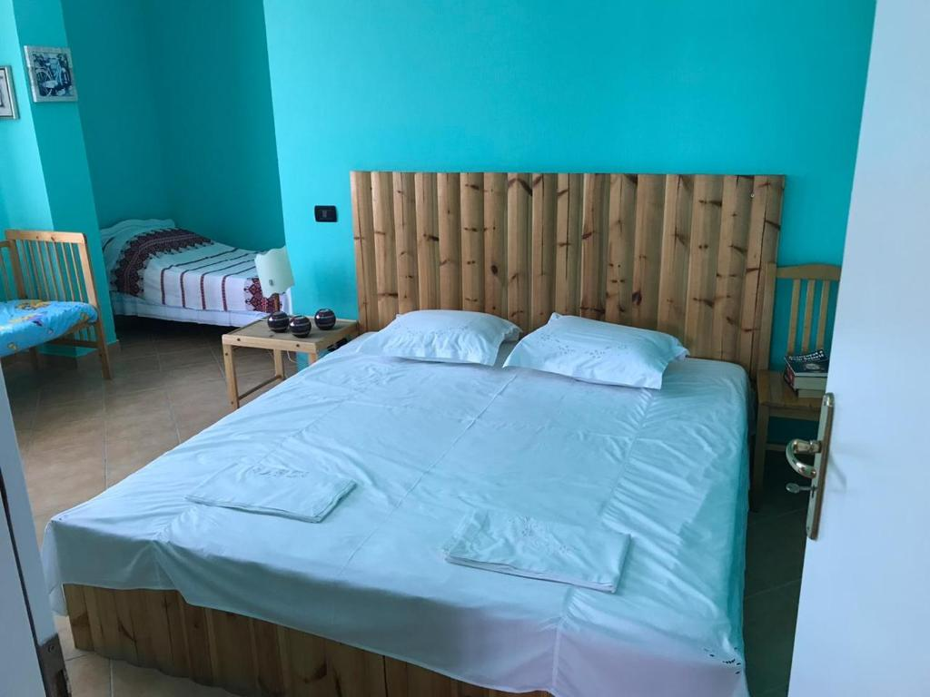A bed or beds in a room at Vila Elmar
