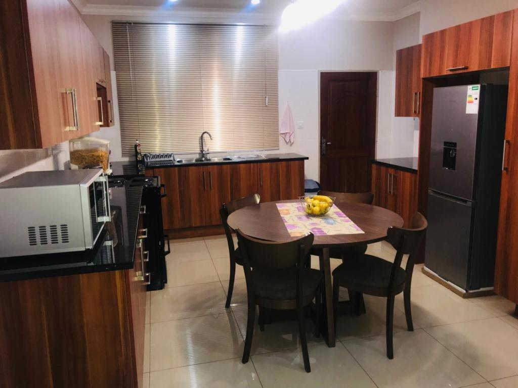 A kitchen or kitchenette at Dede Apartment -A Home Away From Home...
