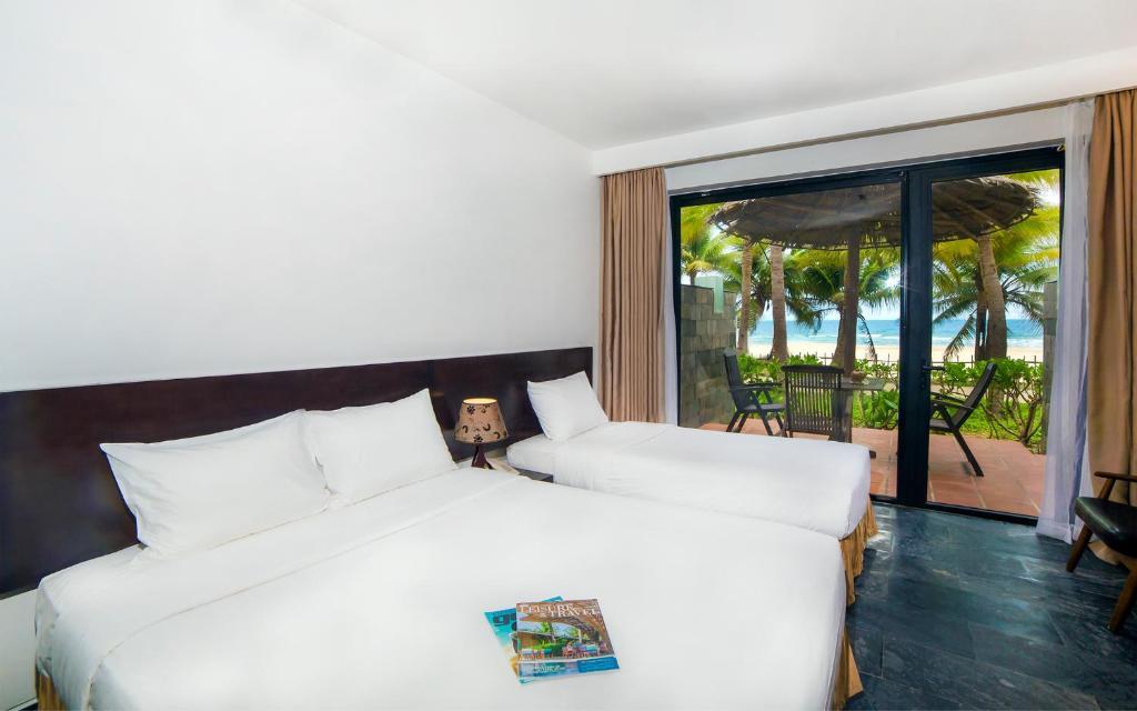 Phòng 2 Giường Đơn - Hướng Ra Bãi Biển Và Có Lối Đi Dẫn Ra Bãi Biển