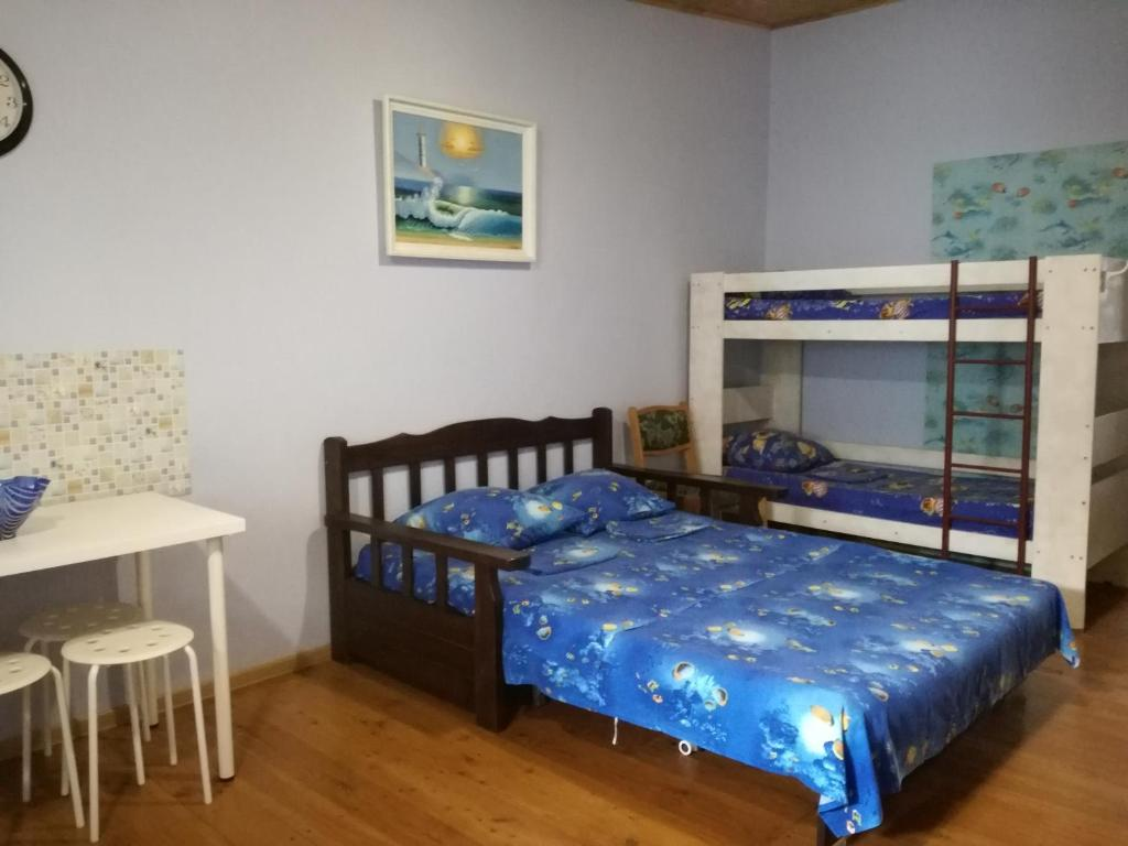 A bunk bed or bunk beds in a room at Guest house Baza otdyha Vodnik